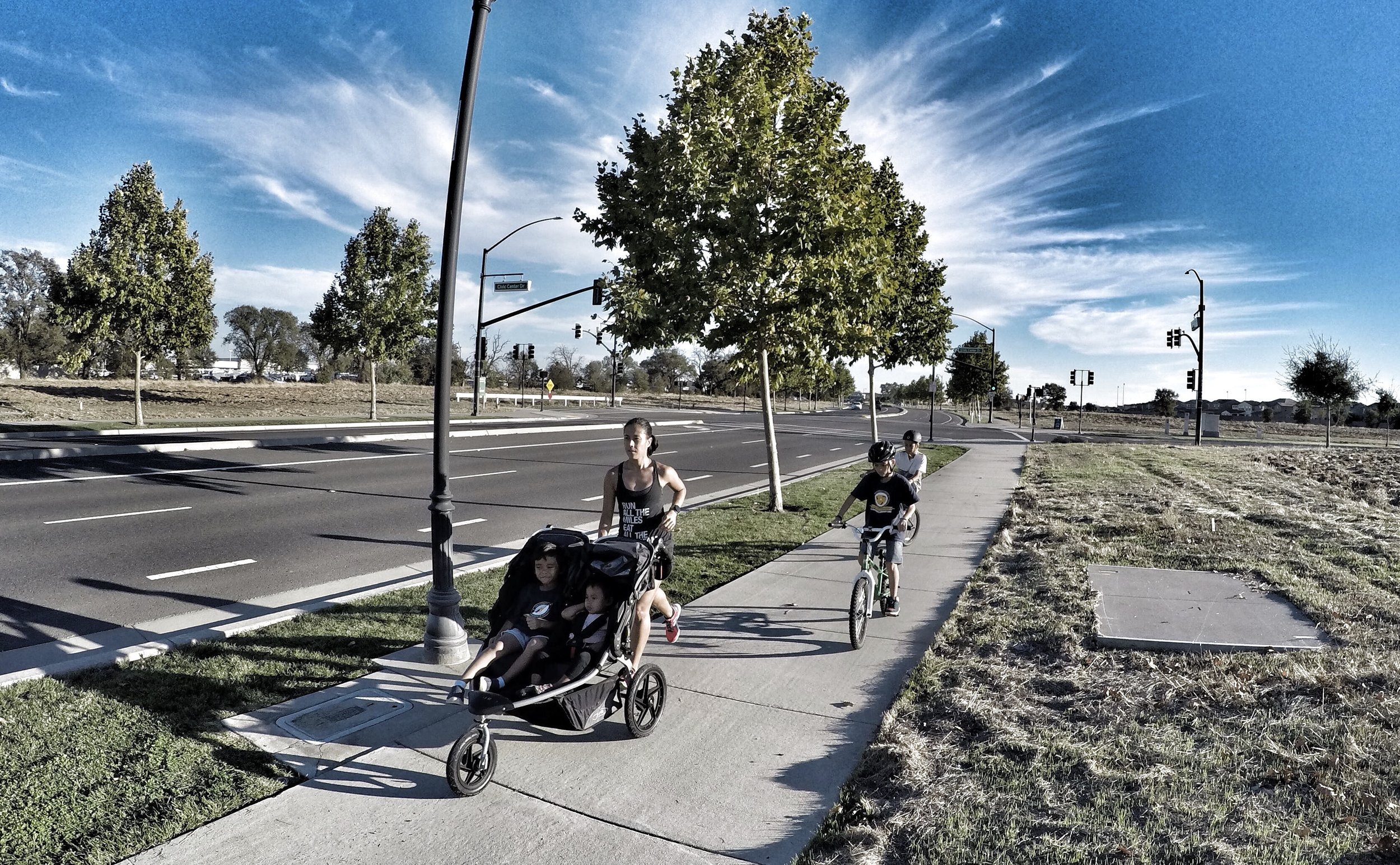The family, minus the husband.  How 90% of my running happens: stroller and bikes running all over town.
