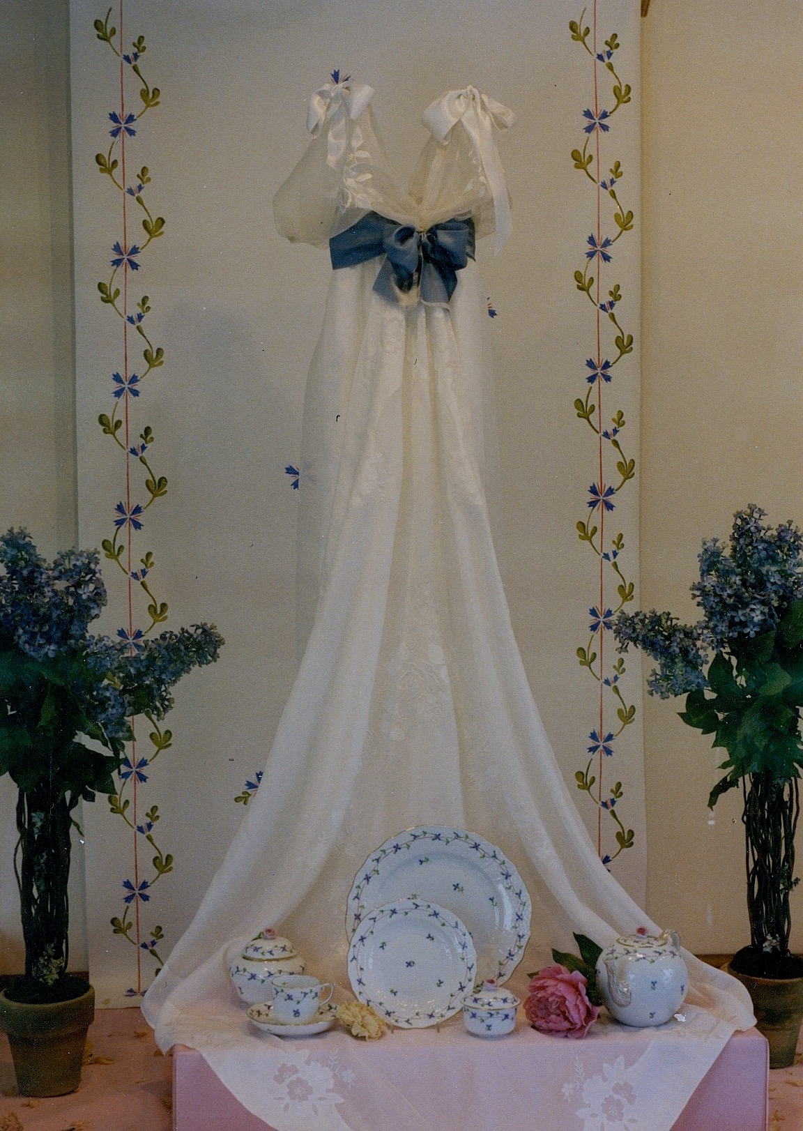 """Herend Porcelain Windows - June Bride window, featuring Blue Garland pattern with wedding dress """"train"""" becoming tablecloth for china place setting"""
