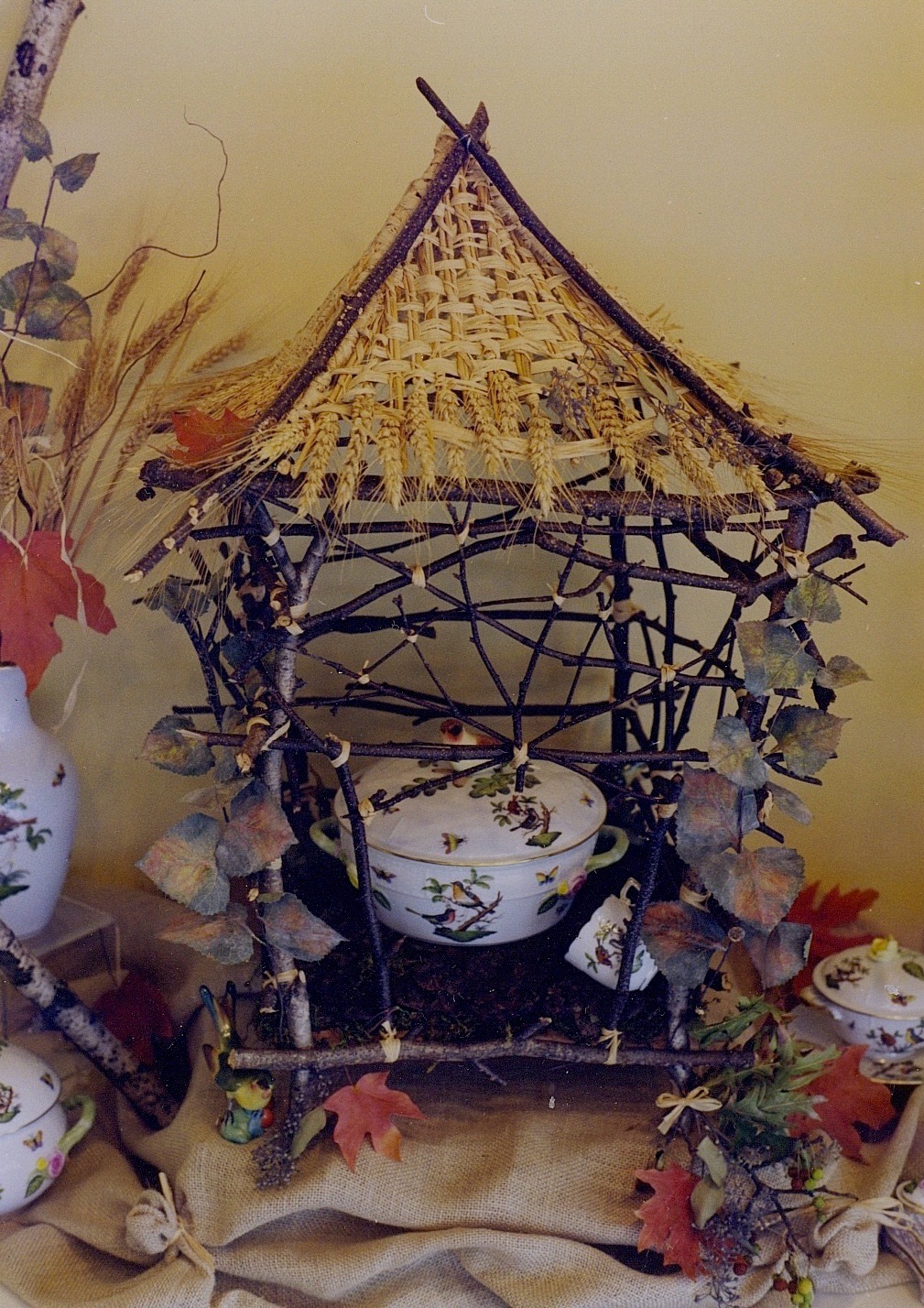 Autumn Window with  Rothschild Bird  pattern set in Chinese Chippendale style pagoda birdcage crafted from birch twigs, with woven wheat roof