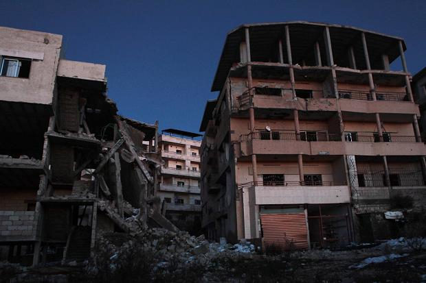 Night falls over damaged apartments in Salma  Times photographer, Tom Pilston