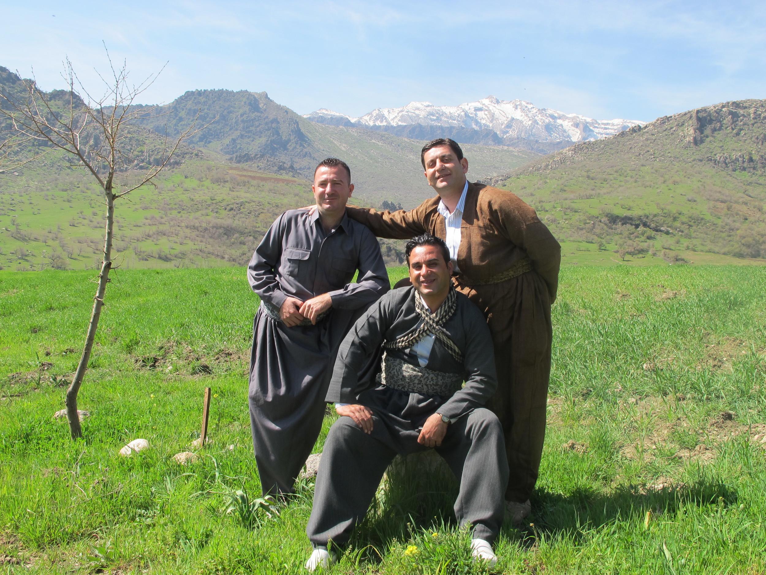 Men in traditional Kurdish dress celebrate Nowruz