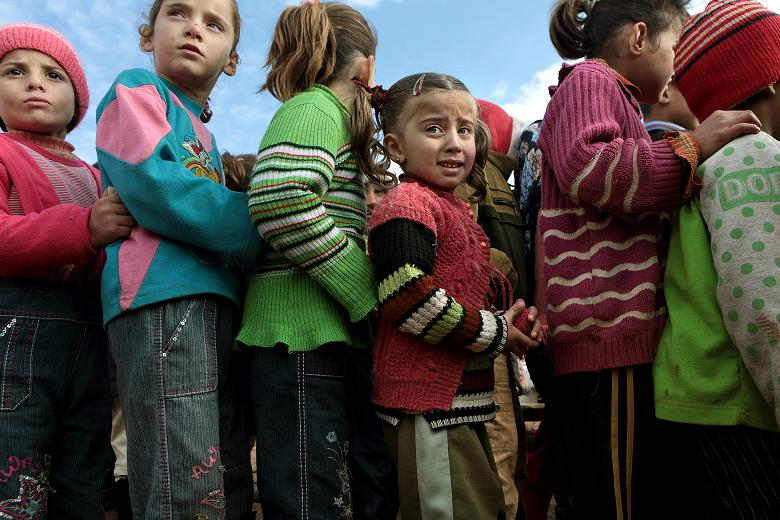 Children queue to register for a new school in Atmeh  Times photographer, Tom Pilston