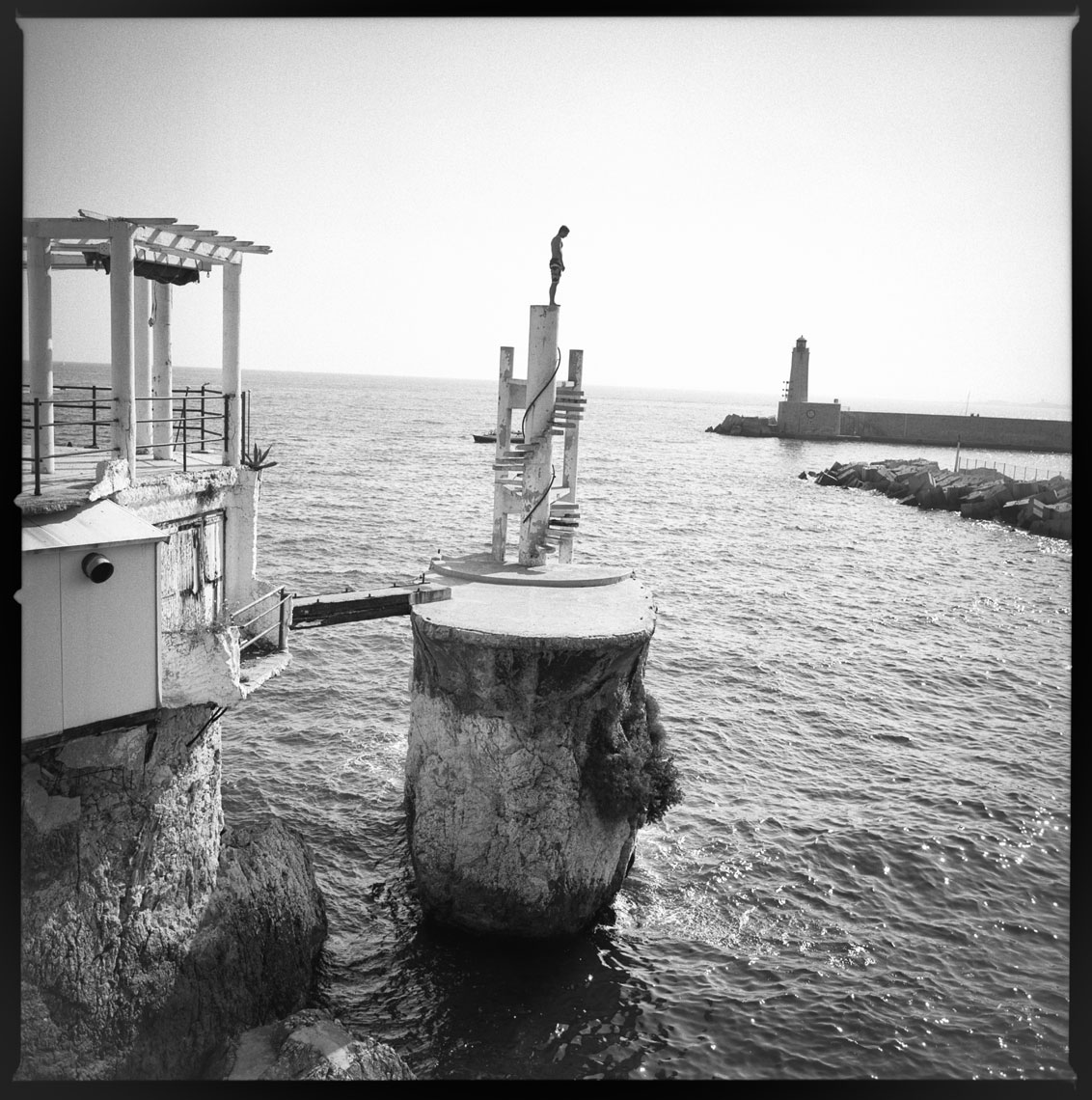 Boy about to dive Nice, France 2011   Made with Hasselblad 501c with Kodak Tri-X 400 b&w film