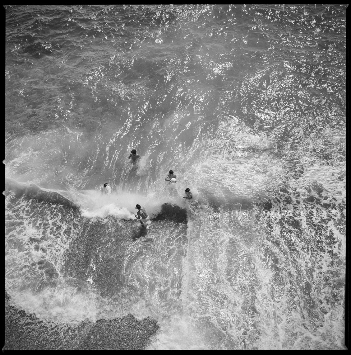 Boys in the waves Nice, France 2012   Made with Hasselblad 501c with Kodak Tri-X 400 b&w film