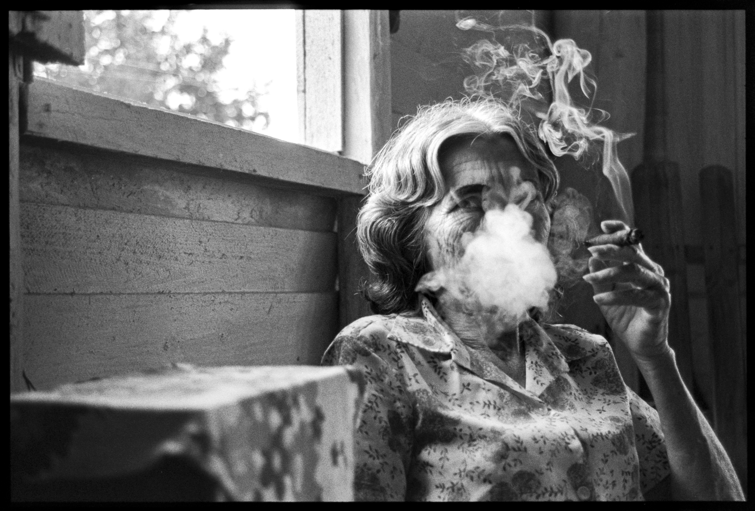 Woman smoking a cigar Viñales, Cuba, 2003