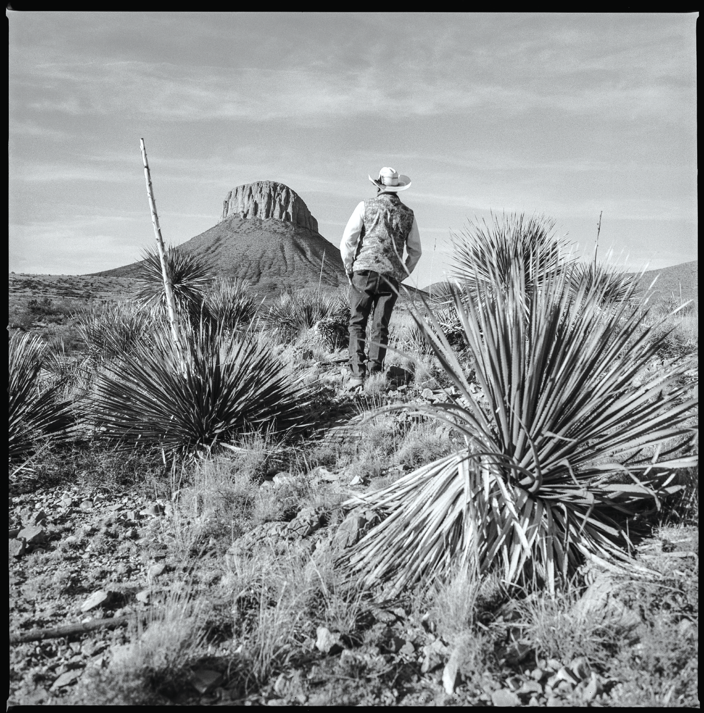 Man surveying land Hudspeth County, 2017   Made with Hasselblad 501c with Kodak Tri-X 400 b&w film