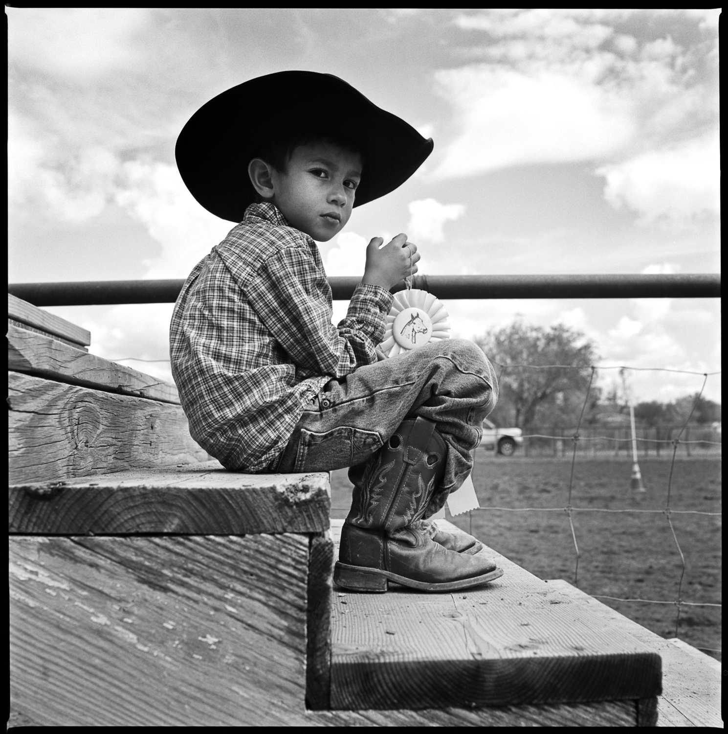 Young cowboy with first prize blue ribbon Ft. Davis, 2012   Made with Hasselblad 501c with Kodak 120 Tri-X 400 b&w film