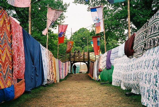'This is festival' 35mm photograph taken with my Pentax ME Super at Eden Festival.  #analoguephotography #filmphotography #filmcamera #filmisnotdead #35mmfilm #35mmphotography #festival #edenfestival #pentaxmesuper #nofilter #summerfestival #textiles #decoration #walkway