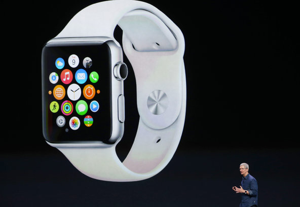 Apple Inc. CEO Tim Cook shows off the Apple Watch during the company's keynote in California on September 9, 2014.