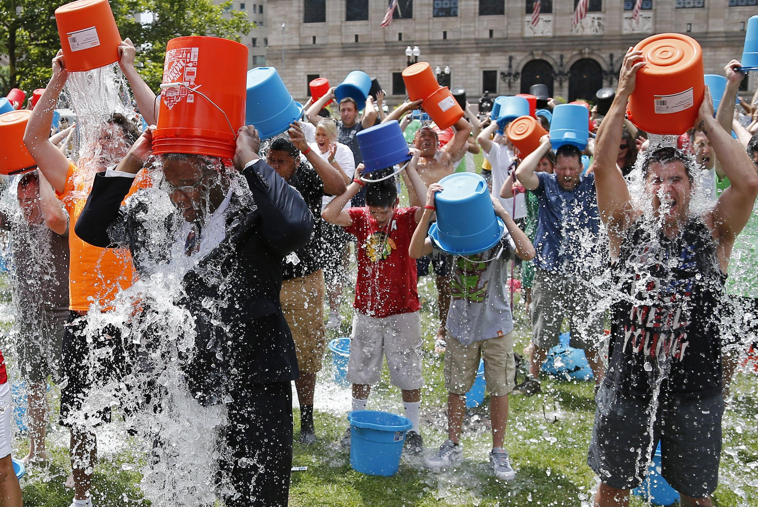 A group of people takes the ALS Ice Bucket Challenge in Boston, MA.