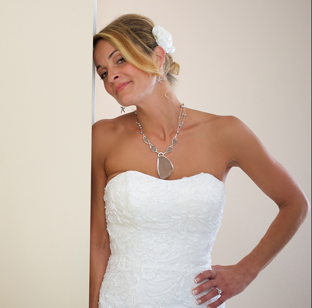 The New Mrs. Gaethofs wears sea glass set in fine silver and hung from a multi strand Swarovski Crystal and fresh water pearl necklace.   Trevor Holden Photography