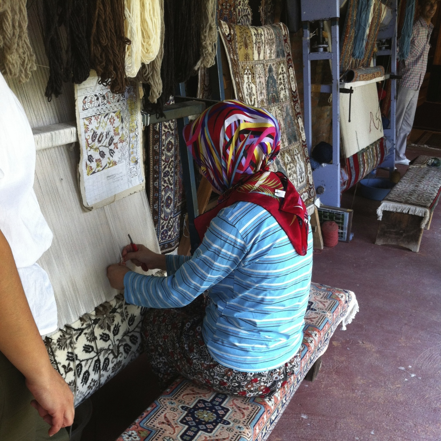 Turkish woman weaving rug