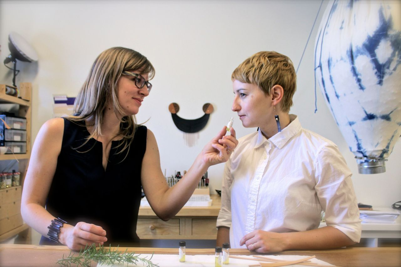 Jessica and Natalie in the Canoe studio sniffing samples.