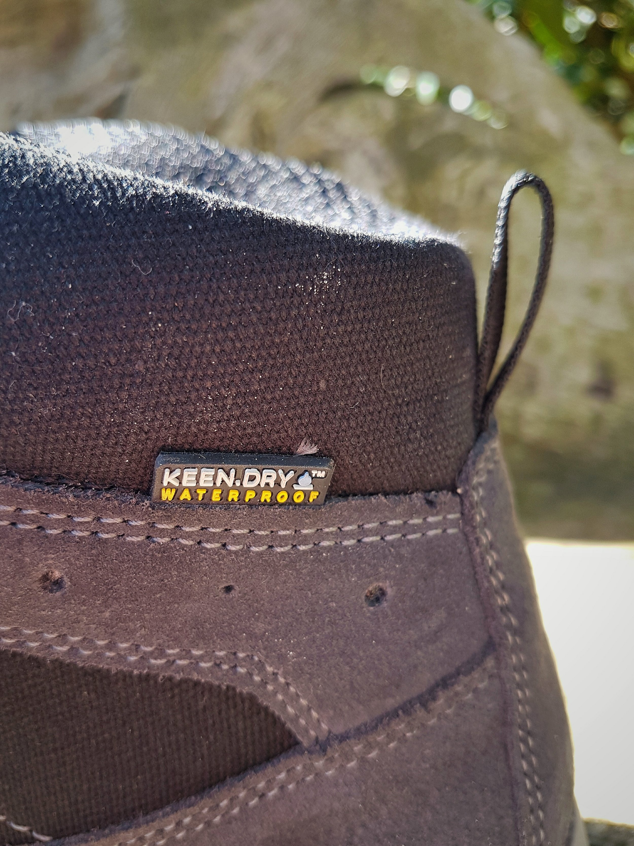 KEEN Waterproofing is clearly visible on the outside of the boot, close to the heel area. The materials on the outer part of the boot are robust mesh and canvas.