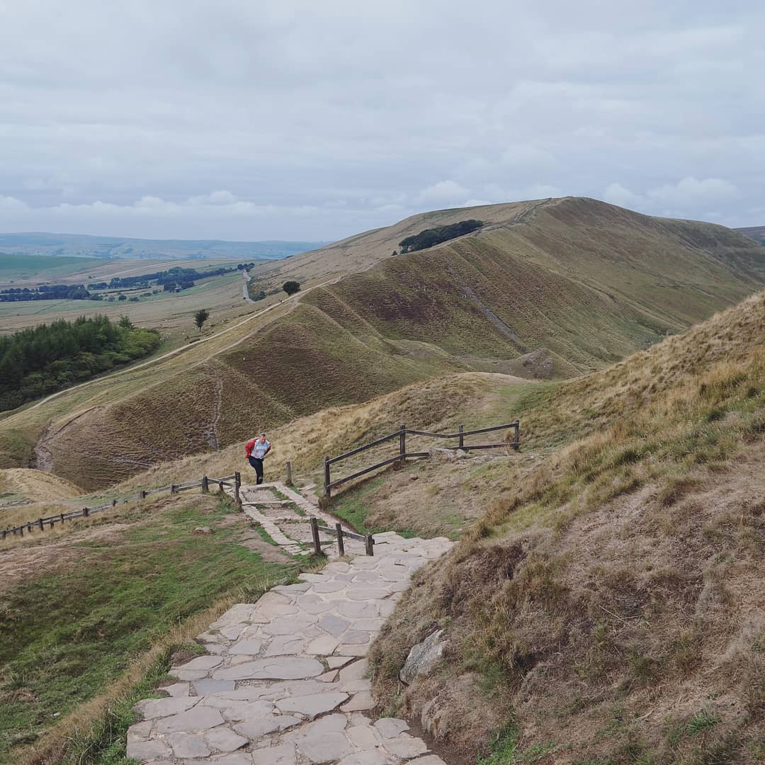 The path leads from the very top of Mam Tor and eventually weaves its way forwards to Rushup Edge, in the distance.