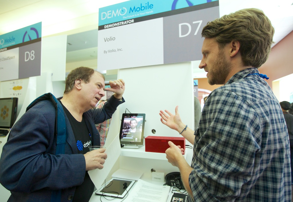 Demonstrating /explaining our product to a fellow entrepreneur at our booth following the presentation.