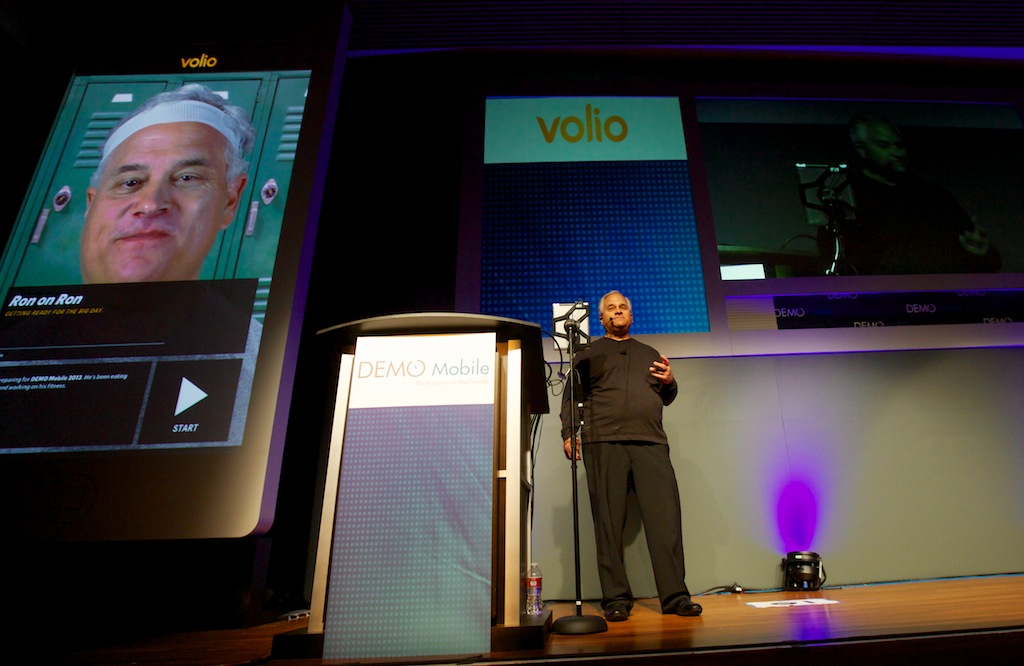 CEO Ron Croen delivering our presentation, which included a live demo of him talking to himself through our Volio application (magnified iPad on the left). I authored our award-winning presentation.