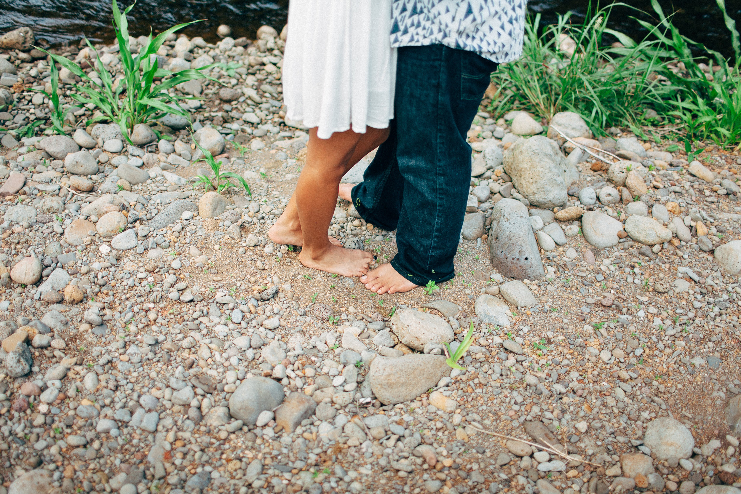 River Engagement Session in the Mountains Mixed Race Couple Chasing Boulders