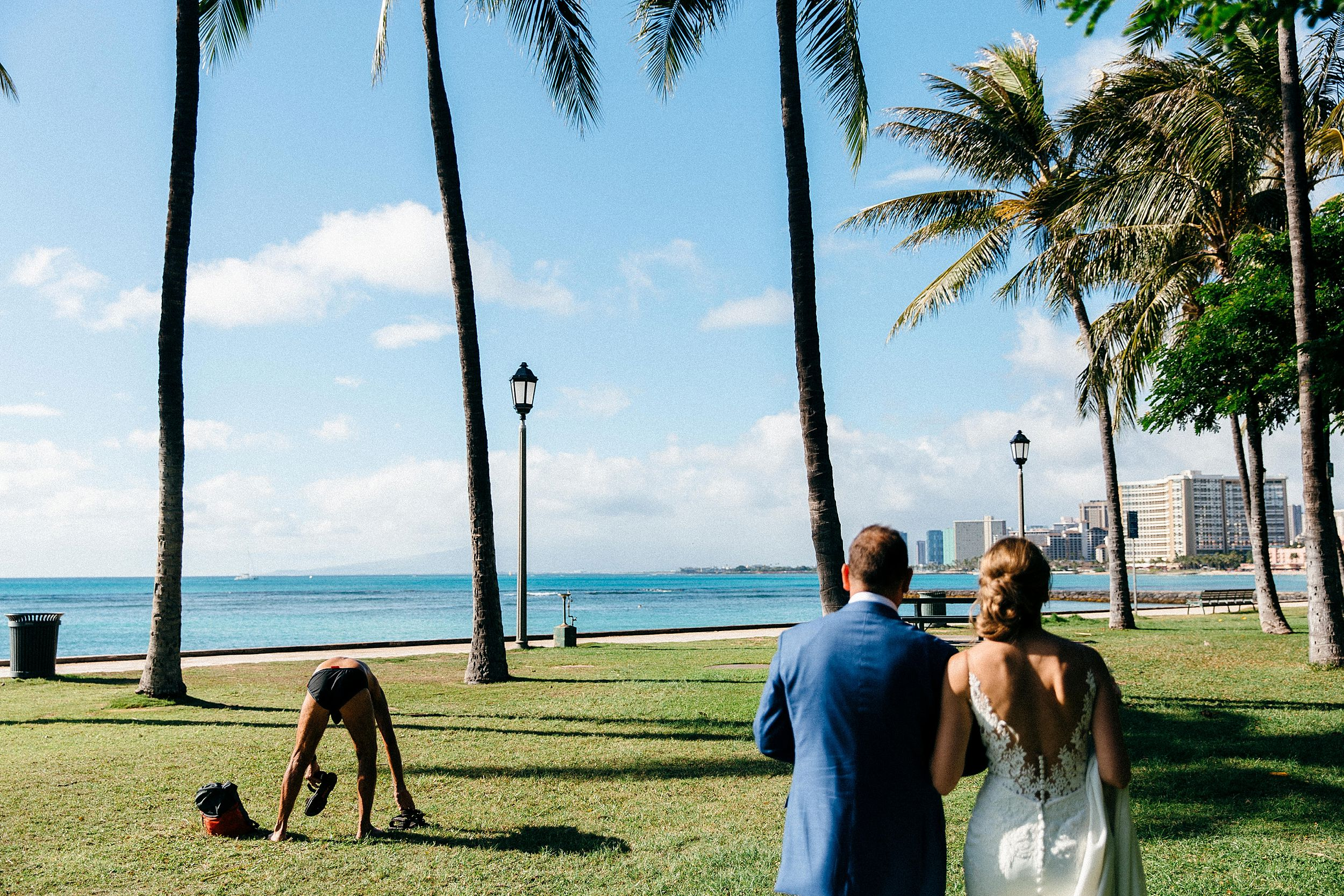 Funny wedding day images - documentary photographs at Waikiki Bay