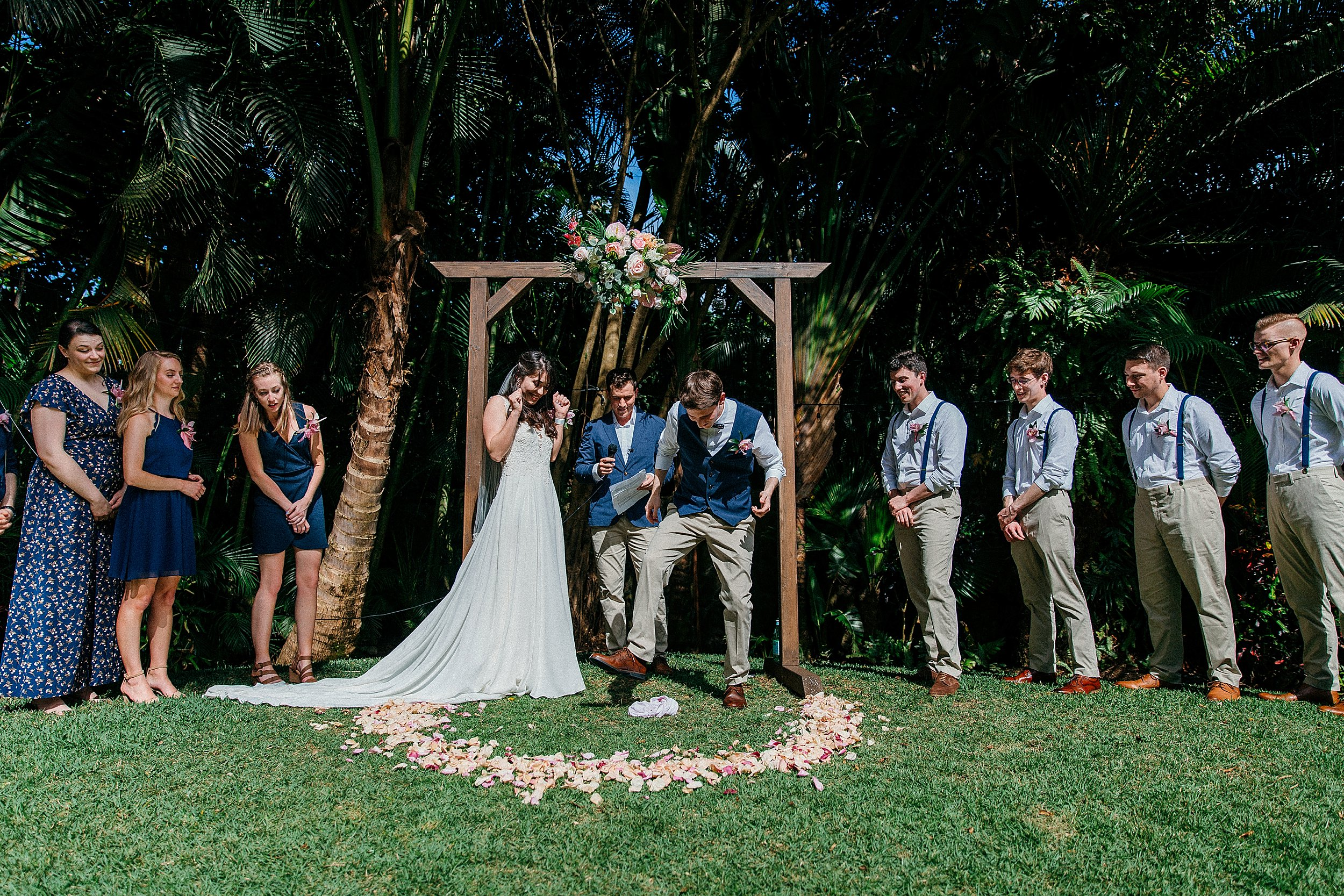 Nikki & Jarred marriage vows in the backyard at Hale Koa in Hawaii with their UD friends and family surrounding them.