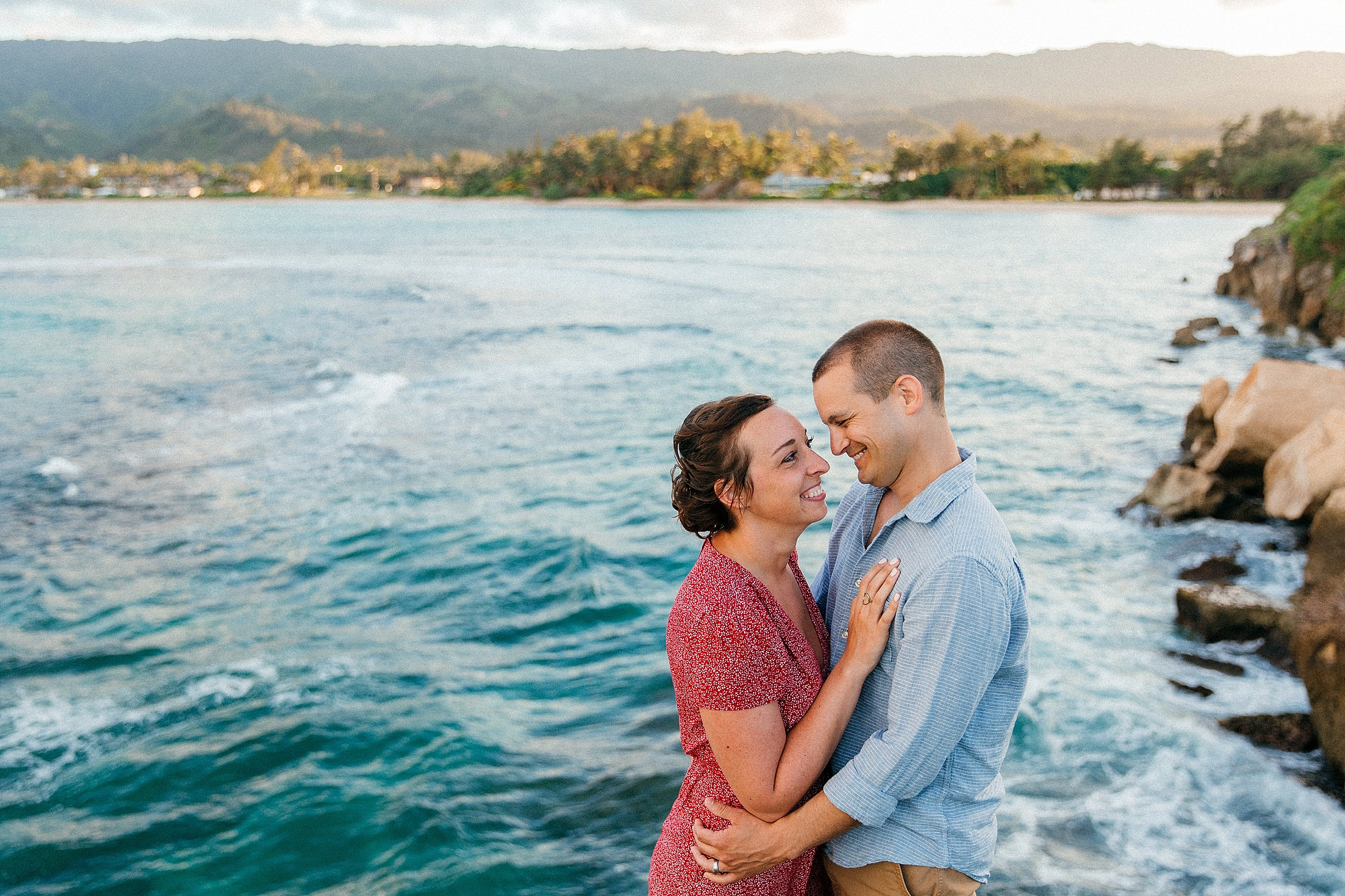 Kelsey & Scott together after 5 years married; they adventured around Oahu and had some vacation photos taken at Laie Point on the North Shore.