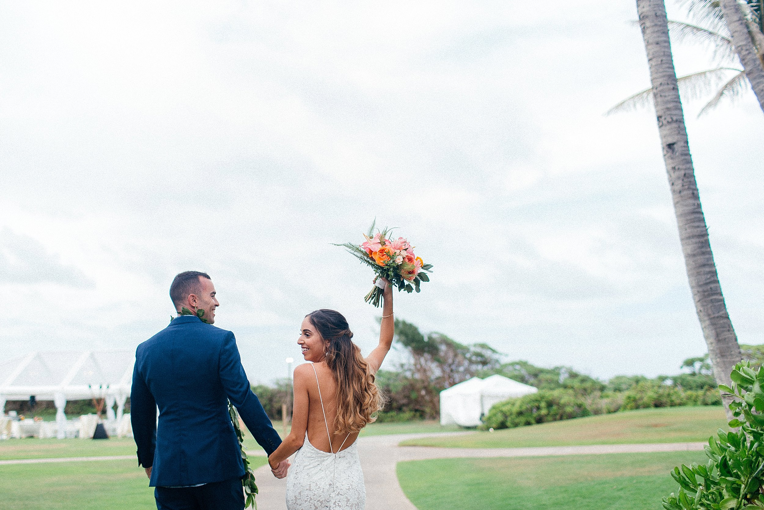 Nicole & Jim celebrating right after their ceremony at Turtle Bay Resort's little white chapel.
