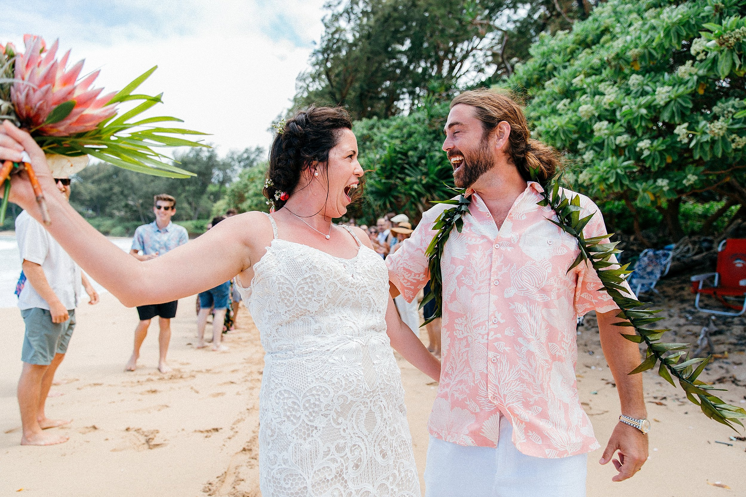 Andy & Allexa celebrate with friends and family on Kokololio Beach after getting married at Mahakea Estate in Hauula, Hawaii.