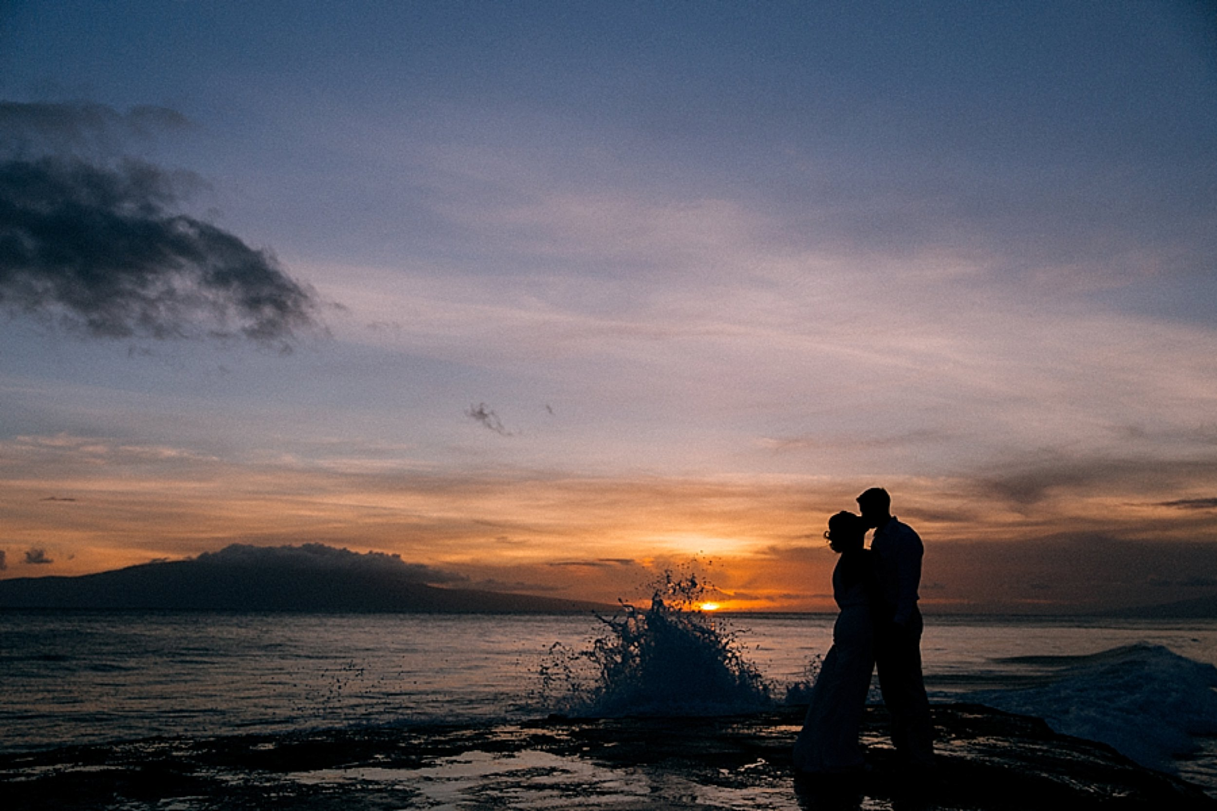 Tayte and Justin catch the sunset together after their ceremony and reception at Olowalu Plantation House on Maui, Hawaii.