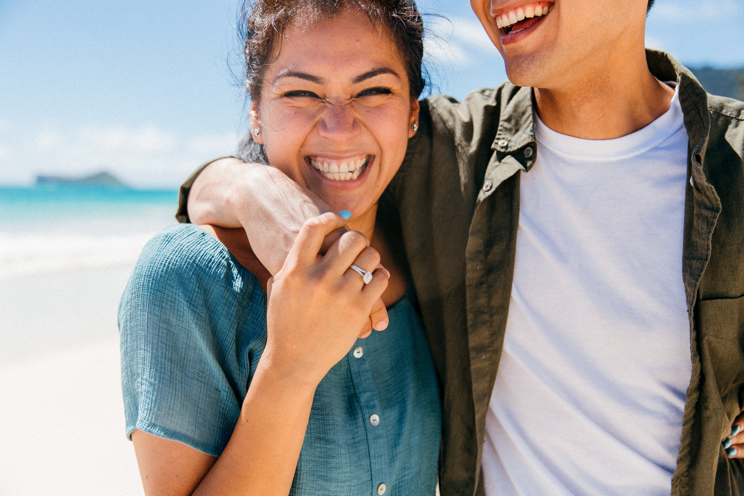 Daniel proposed to Sinday at Waimanalo Beach on July 4th weekend near Honolulu, Hawaii at the base of the Koolau Mountain Range.