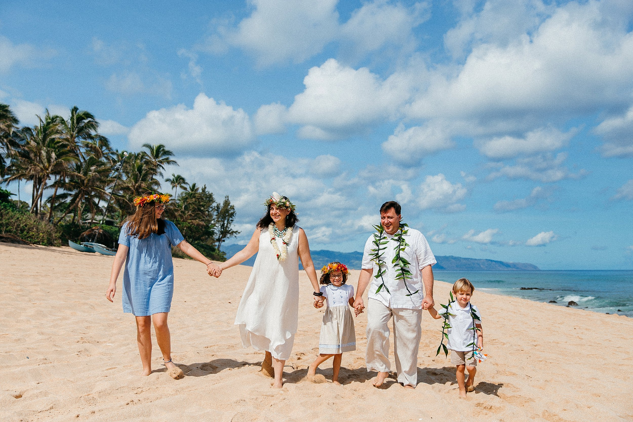 Vow renewal and family photographs on North Shore, Hawaii.