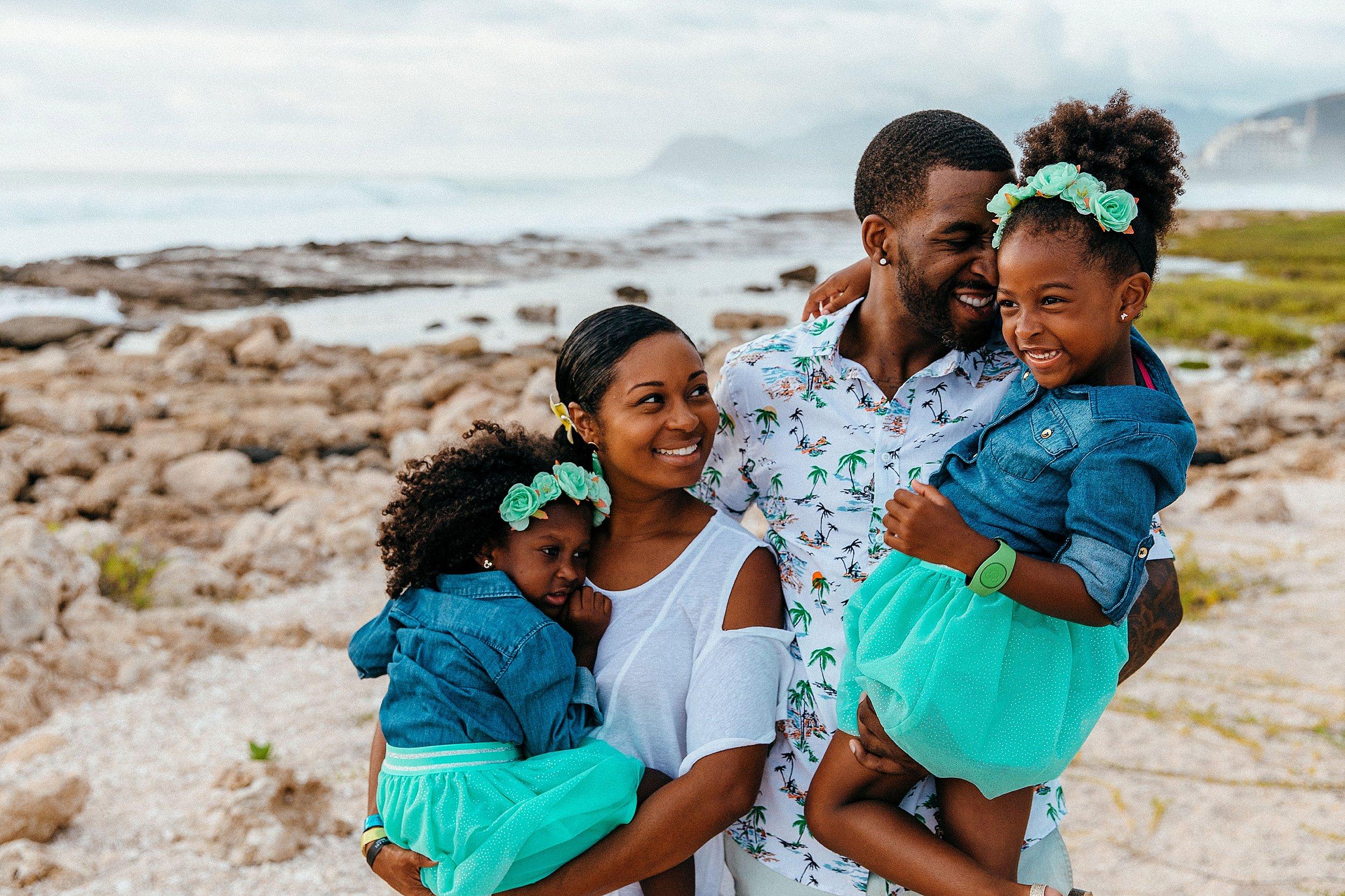 Family session at Ko Olina Lagoon near the Marriott in Kapolei, Hawaii.