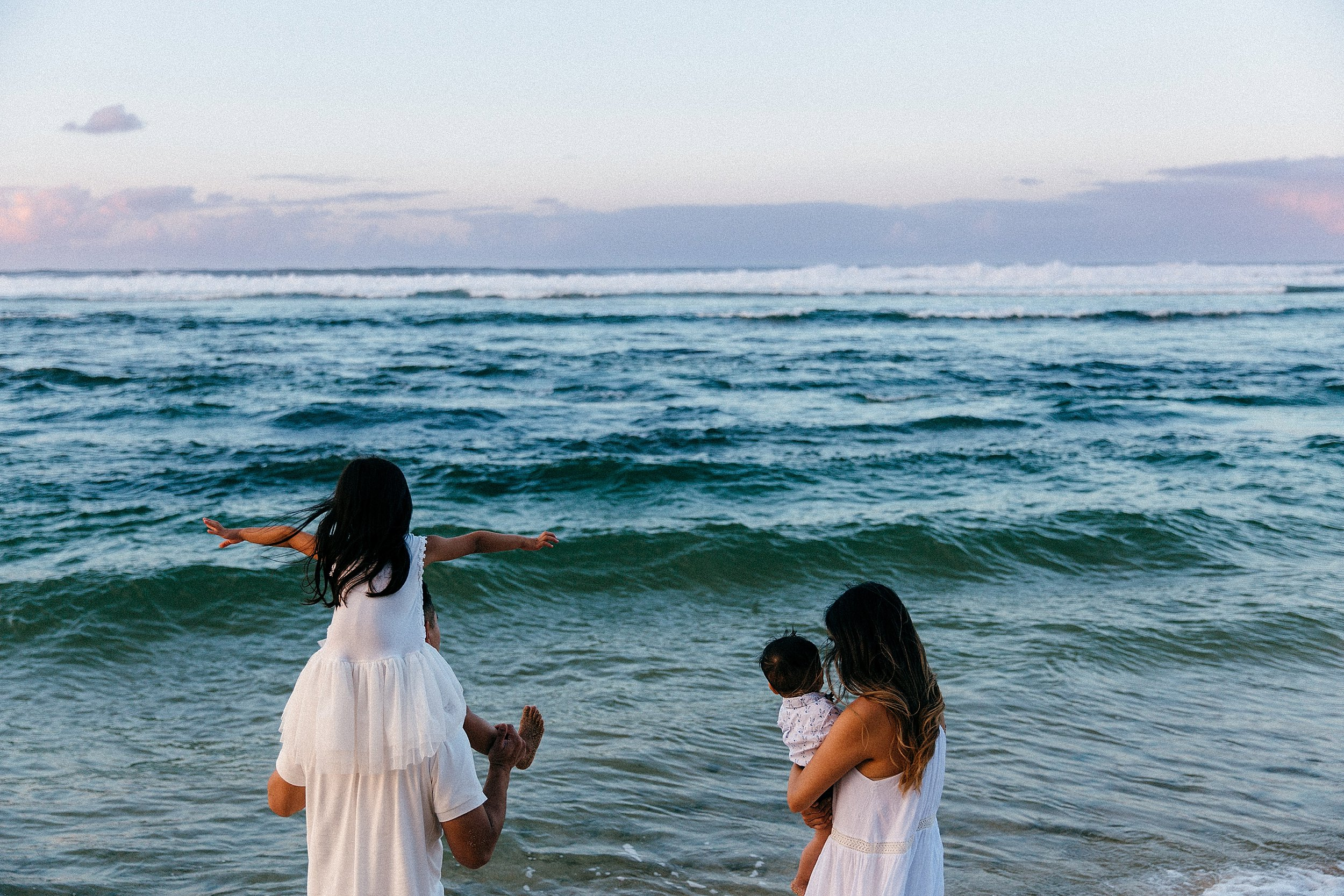 Fun and playful family vacation at Mokuleia Beach in Hawaii.