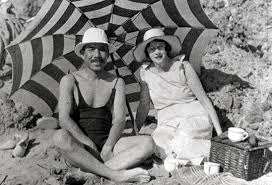 Taketsuru and wife pictured drinking (what we would like to assume) are mugs of his favourite whisky at the beach