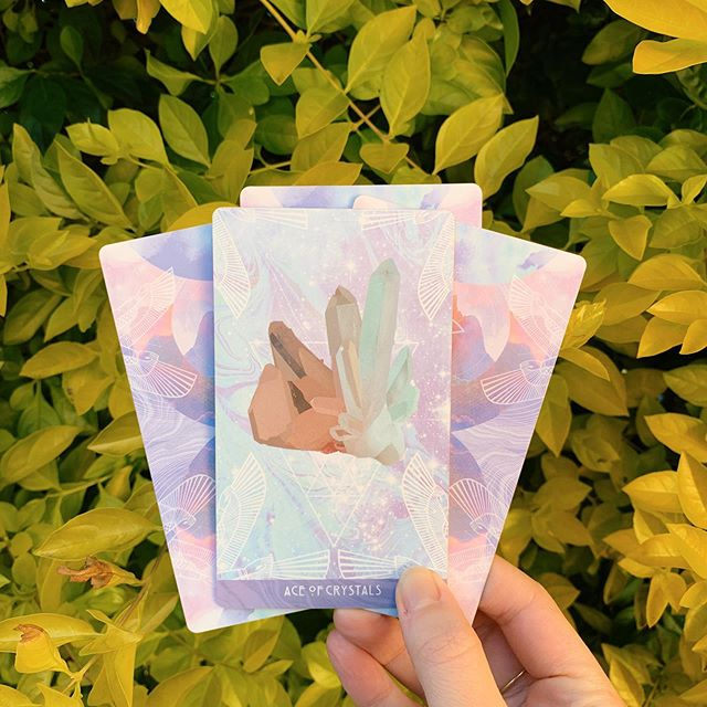 Today's Weather is from the #StarchildTarot. Back in stock now at twosidestarot.com ✨⠀ ⠀ WEATHER REPORT - ACE OF CRYSTALS. ⠀ ⠀ What a perfect card for this wild and wacky Capricorn eclipse! The Ace of Crystals takes us back to basics. While all these big stories and intense vibes are being dredged up, we should think about the fundamentals.⠀ ⠀ Are your feet on the ground? Did you have breakfast? Are you drinking enough water? Did you get to have your coffee just the way you like it? Did you pay that bill that's due? Have you got money for the bus? ⠀ ⠀ Basic, basic stuff today. Are you fed, are you watered, do you have the simple resources on hand that you'll need to get through the day? ⠀ ⠀ If so, maybe consider some next level Ace of Pentacles stuff. Go outside, sink your fingers into the ground. Sweep your floors. Weed your garden. Put your laundry away. Stretch. Tend to your space and your body. ⠀ ⠀ Do simple things that remind you that you're a creature here on earth. Don't worry about big ideas or bold plans today. Just be here, with your roots planted and your face turned towards the sun. And don't forget your SPF!