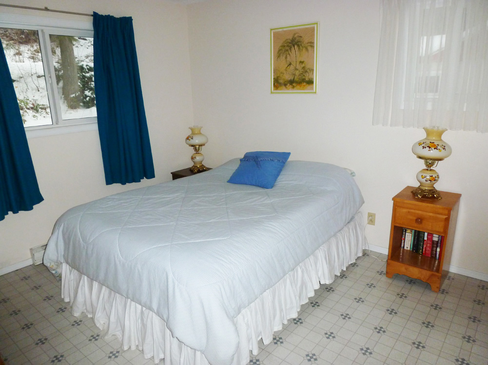 Upstairs bedroom with one double bed.