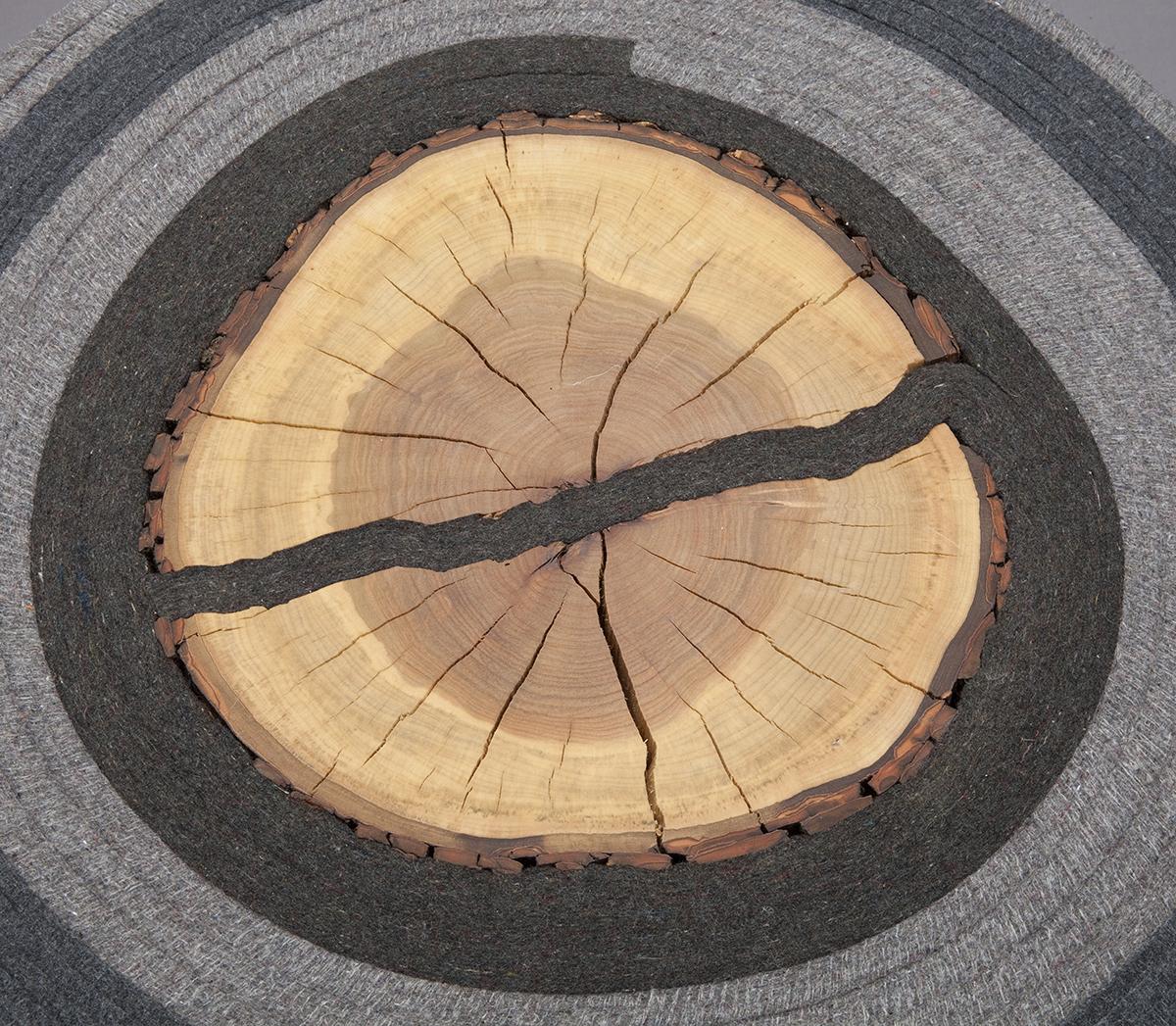 Roll Up 3–Detail  |  2007   |  felt, firewood, steel  |  14 x20