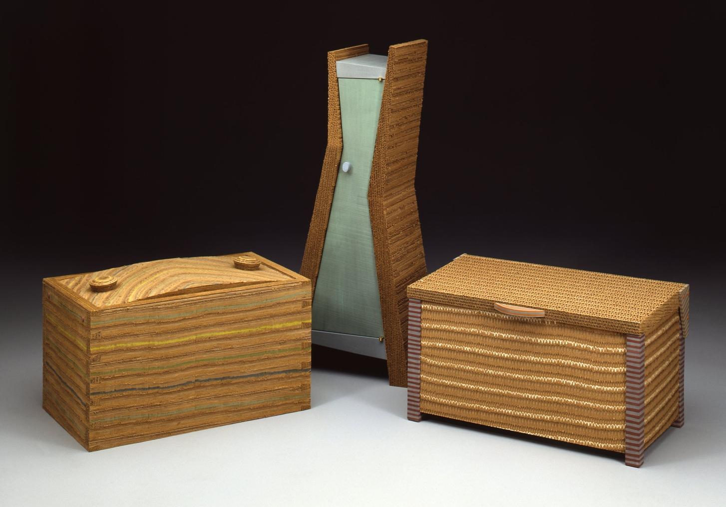 (left to right) Dovetail Box I 1990 I corrugated paper I 15 x 23 x 14    Zig Zag Cabinet I 1992 I corrugated paper, wood, paint I 32 x 16 x 10     Lidded Chest I 1990 I corrugated paper, wood, paint I 14 x 24 x 14