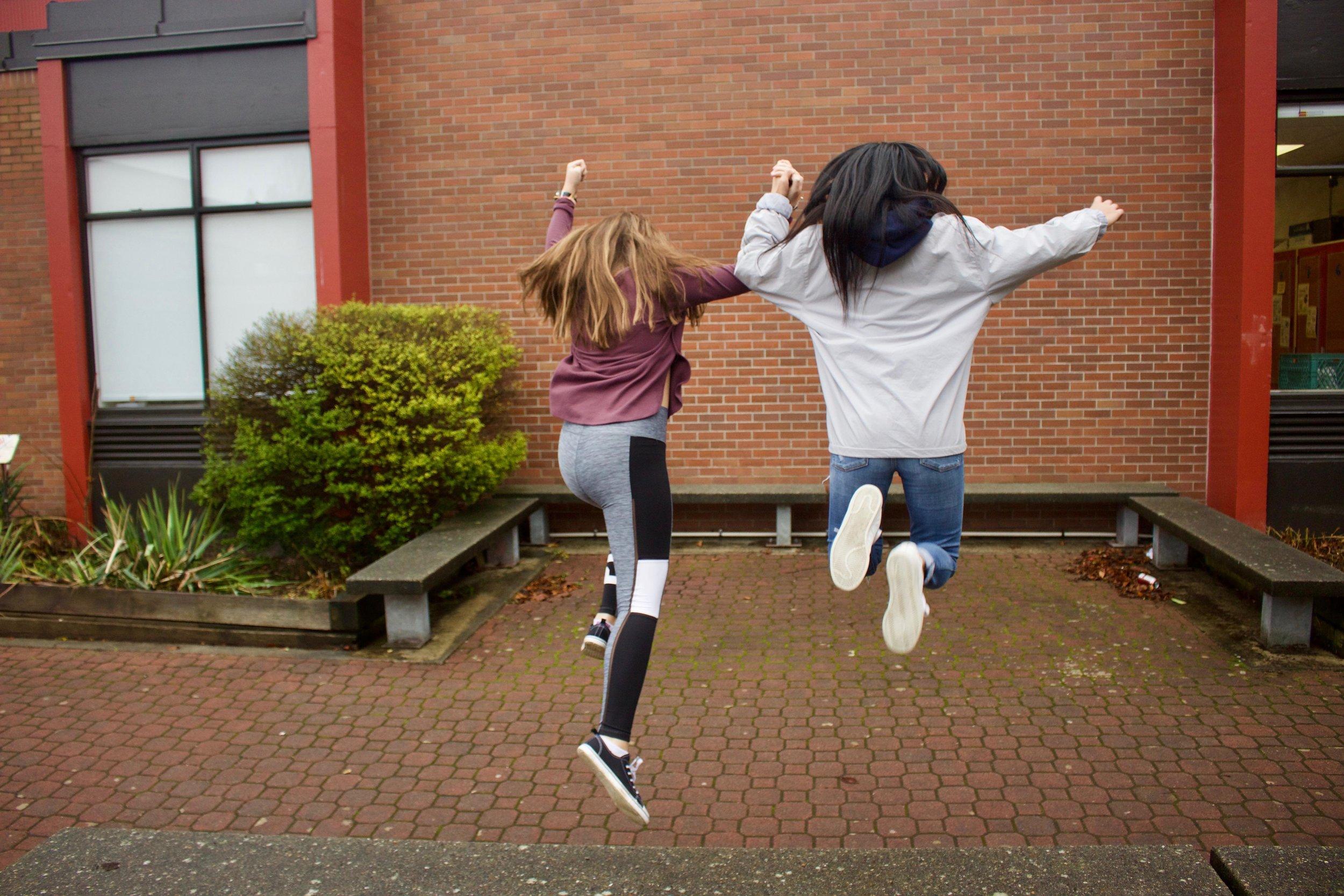 2girlsjumping.jpg