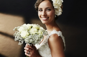 37847166 - stunning young bride holding bouquet, portrait