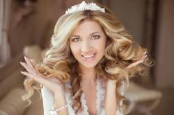 46512339 - hair. beautiful brunette bride girl. wedding makeup. healthy long hair. beauty model woman. indoor portrait.