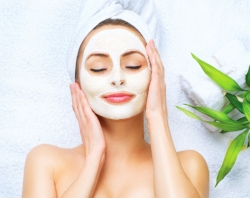 43729536 - spa woman applying facial cleansing mask