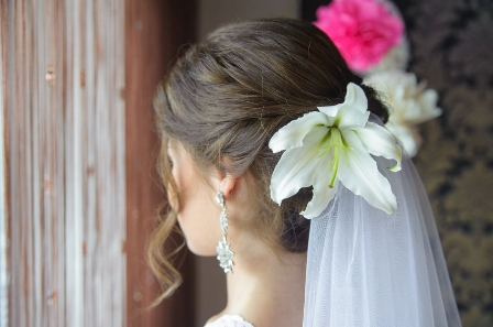52328419 - beautiful hairstyle bride with white flower