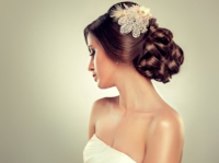 42526887 - girl bride in wedding dress with elegant hairstyle.