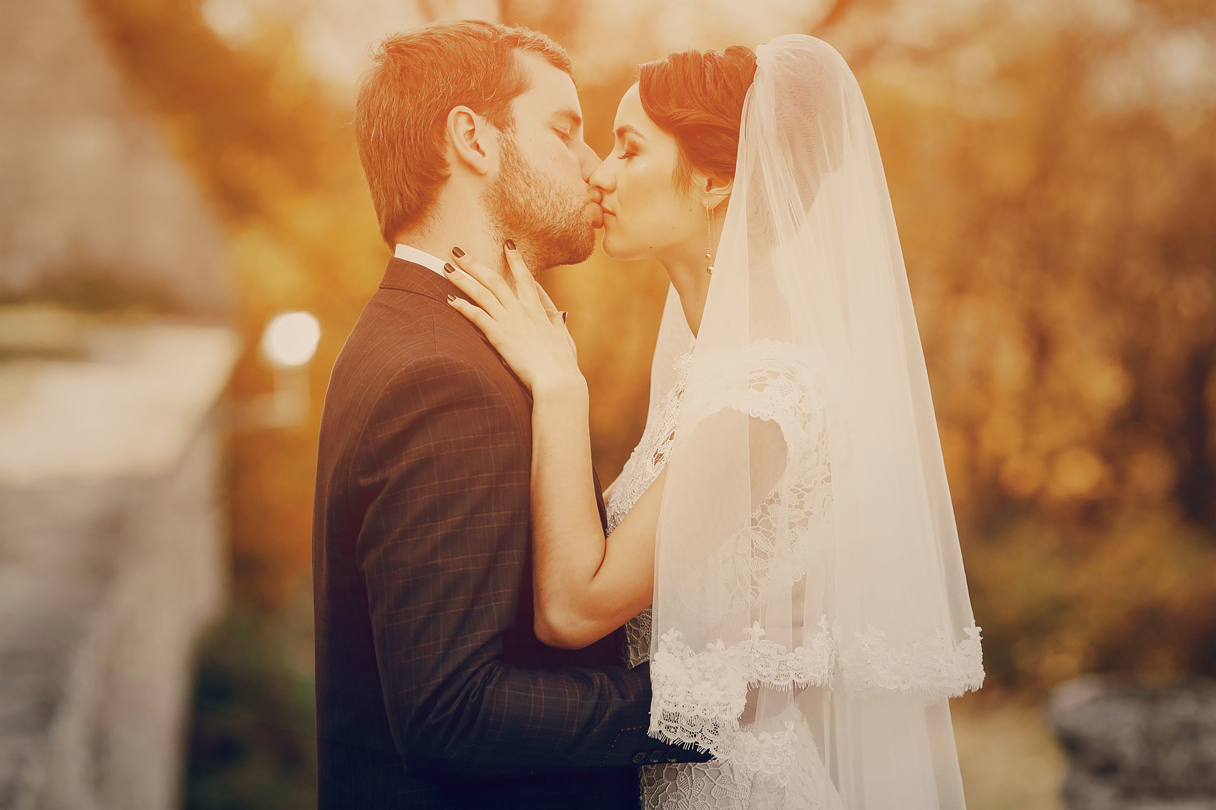 45258244 - happy couple whose wedding photo shoot in a golden autumn