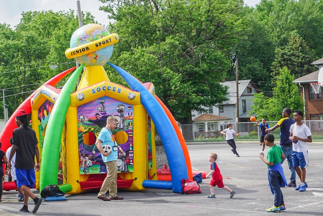 Children enjoy the jump house at a carnival promoting The Chapel Akron VBS,  Superhero City: Unleashing Your Amazing!  More than 100 people attended the VBS, including 25 children who attended carnivals at schools surrounding The Chapel.