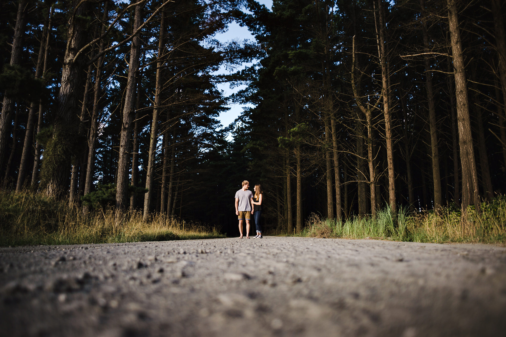 3a couple in middle of road next to woods.jpg