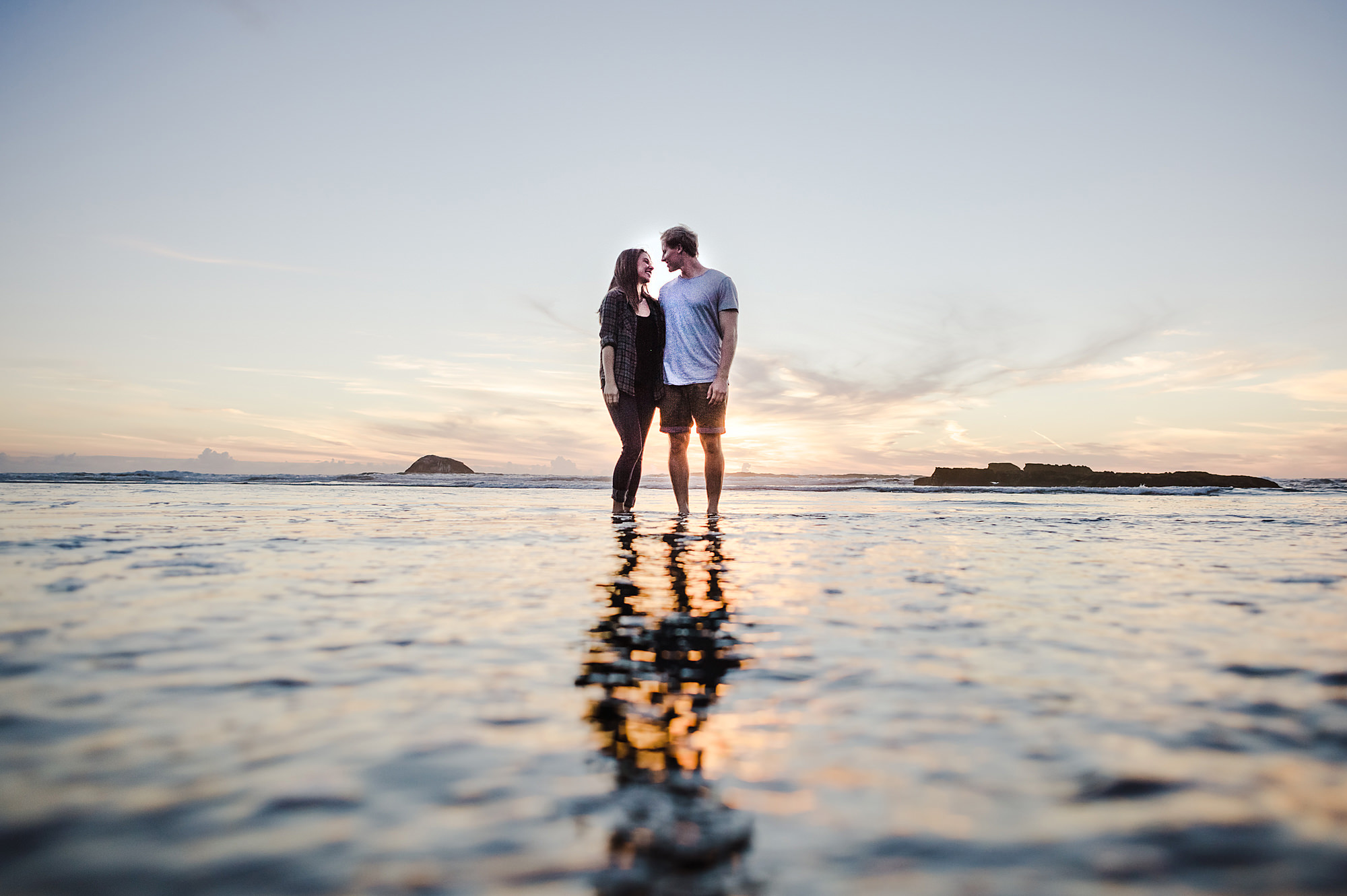 16 couple in water at beach sunset.jpg