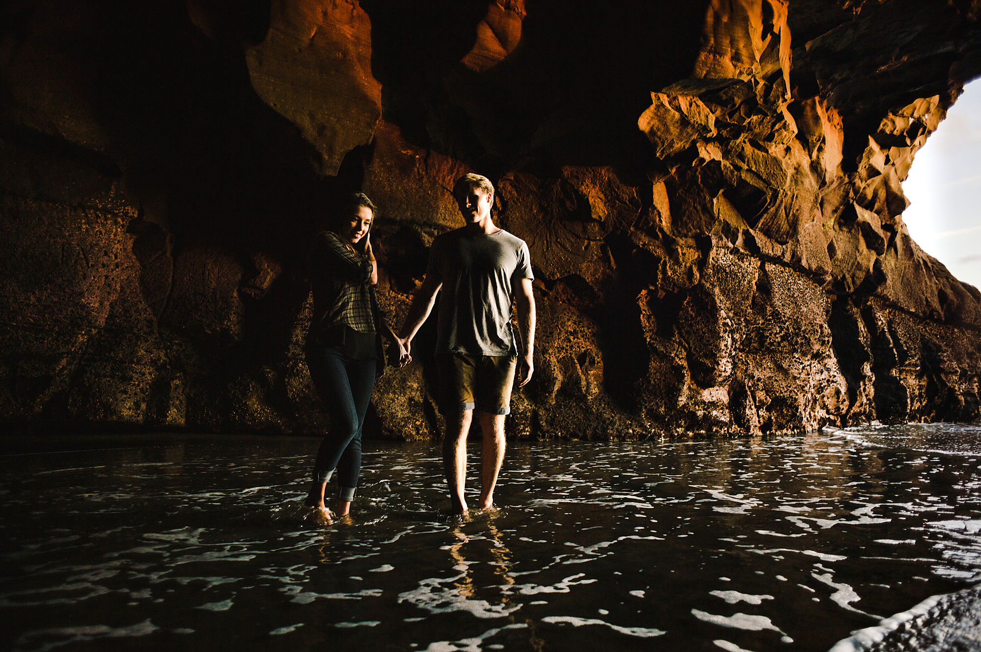 13 Couple splashing in cave at sunset.jpg