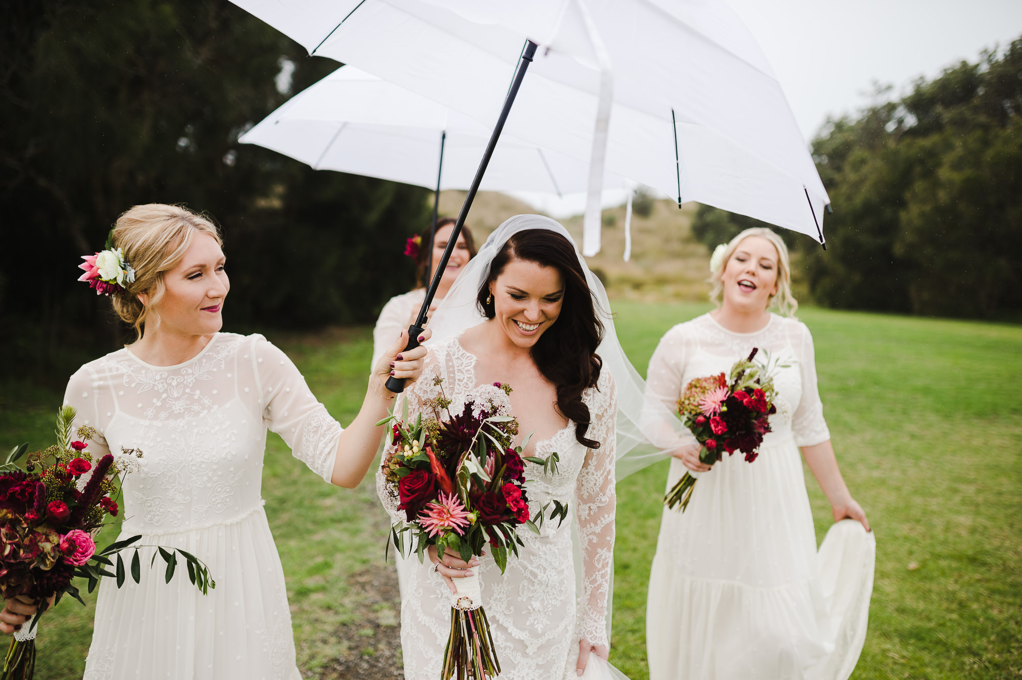 bridesmaids having fun in rain.jpg