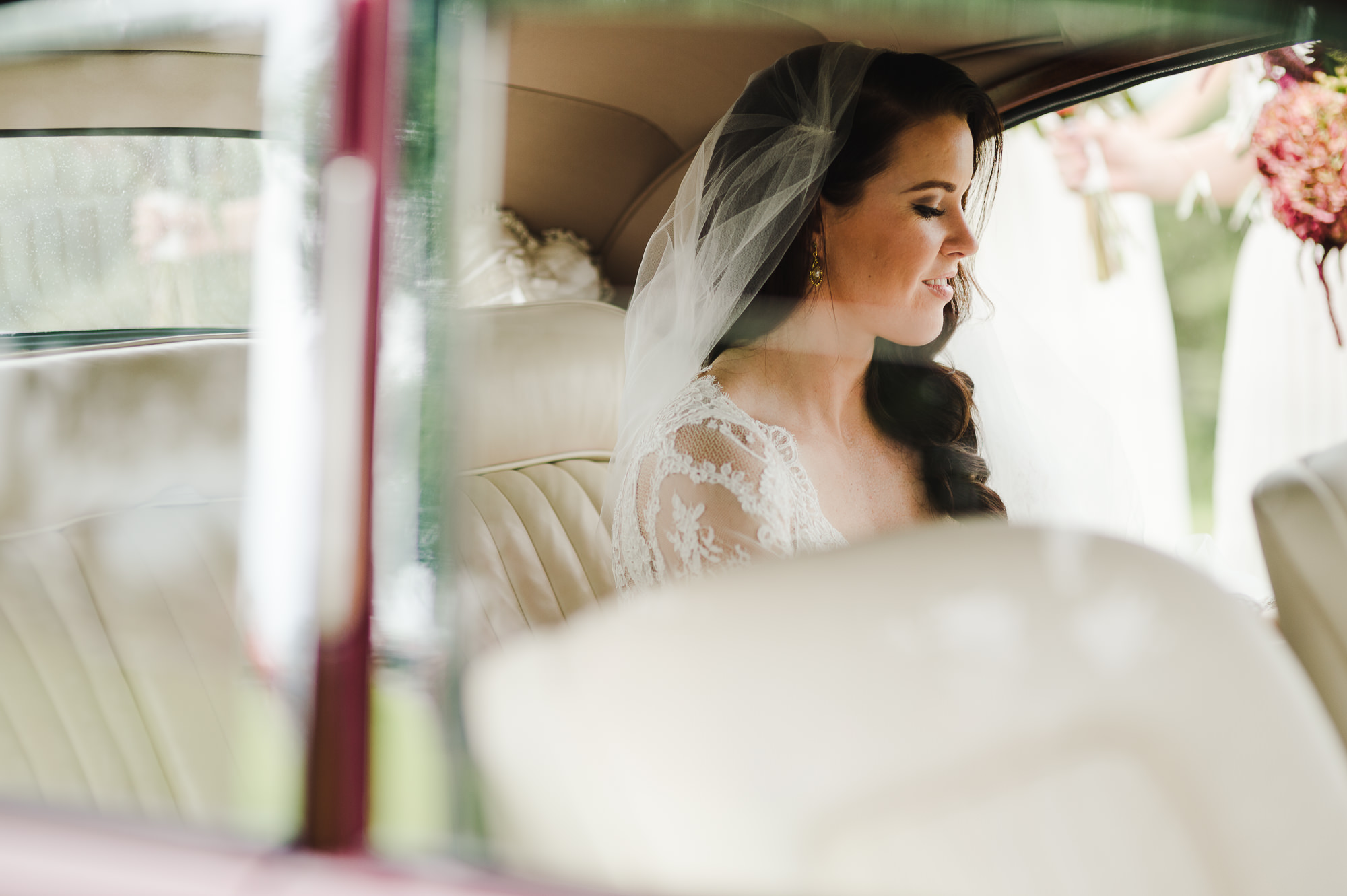 bride waiting in jaguar.jpg